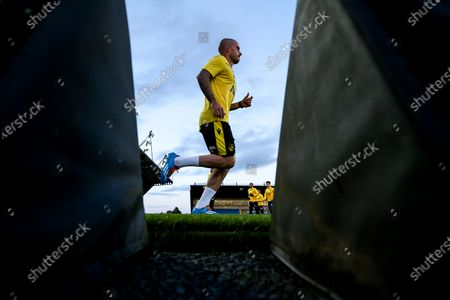 Michael Kelly of Bristol Rovers warms up