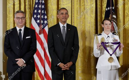 """President Barack Obama awards the 2015 National Medal of Arts to director and playwright, Moises Kaufman, left, during a ceremony in the East Room of the White House in Washington on Sept. 22, 2016. Kaufman is directing his first play in Spanish based on Jonathan Jakubowicz's debut novel """"Las aventuras de Juan Planchard."""" The opening in Miami has been delayed due to the coronavirus pandemic, but five scenes are being presented online on"""