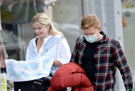 Sam Aston and wife Briony and baby Sonny enjoy lunch.