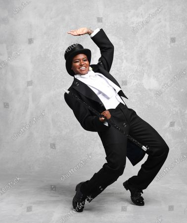 Stock Picture of She might be more accustomed to boxing gloves and shorts, but Nicola Adams looked equally at home in top hat and tails as she replicated the moves of Hollywood legend Fred Astaire.  The former Olympic gold medal-winning boxer was posing exclusively for the Mail as she prepares to become Strictly Come Dancing's first contestant with a same-sex dance partner. Miss Adams, 37, who retired from the ring last year, said: 'I've been asked to do Strictly every year since 2012 but it's not been possible while I was always in training, so this year I was super excited to be able to take part.