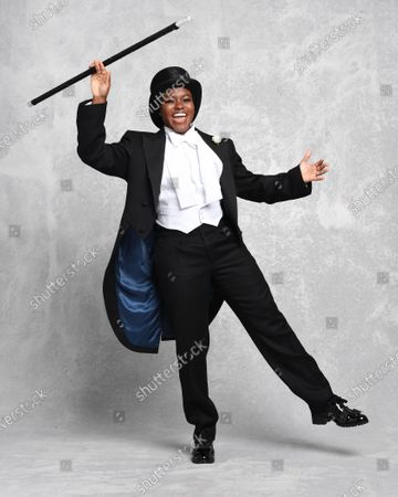 Stock Photo of She might be more accustomed to boxing gloves and shorts, but Nicola Adams looked equally at home in top hat and tails as she replicated the moves of Hollywood legend Fred Astaire.  The former Olympic gold medal-winning boxer was posing exclusively for the Mail as she prepares to become Strictly Come Dancing's first contestant with a same-sex dance partner. Miss Adams, 37, who retired from the ring last year, said: 'I've been asked to do Strictly every year since 2012 but it's not been possible while I was always in training, so this year I was super excited to be able to take part.