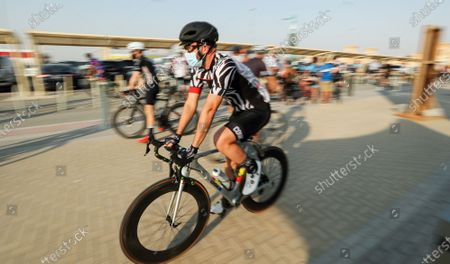 Cyclists wear protective masks as they take part in 'Ride With Lance' in the Gulf emirate of Dubai, United Arab Emirates, 06 October 2020. The US professional cyclist Lance Armstrong invited Dubai cyclists to ride along with him for 50Km loop at the Al Qudra Cycling Track outside Dubai while observing all of the COVID-19 preventive regulations.