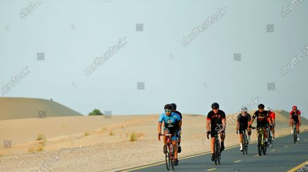 Stock Picture of Cyclists take part in 'Ride With Lance' in the Gulf emirate of Dubai, United Arab Emirates, 06 October 2020. The US professional cyclist Lance Armstrong invited Dubai cyclists to ride along with him for 50Km loop at the Al Qudra Cycling Track outside Dubai while observing all of the COVID-19 preventive regulations.
