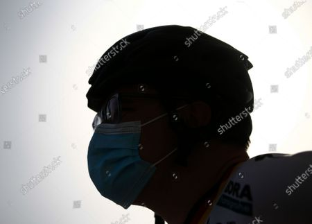A cyclist wears a protective mask while taking part in 'Ride With Lance' in the Gulf emirate of Dubai, United Arab Emirates, 06 October 2020. The US professional cyclist Lance Armstrong invited Dubai cyclists to ride along with him for 50Km loop at the Al Qudra Cycling Track outside Dubai while observing all of the COVID-19 preventive regulations.