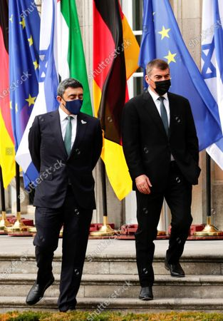 Stock Photo of Foreign Minister United Arab Emirates Sheikh Abdullah bin Zayed Al Nahyan, left, and Foreign Minister of Israel Gabi Ashkenazi, right, stand in front of Villa Borsig, in Berlin, Germany The Foreign Ministers of Israel and the United Arab Emirates meet for the first time