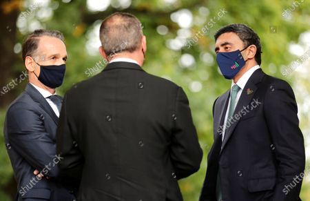 German Federal Foreign Minister Heiko Maas, left, speaks with Foreign Minister United Arab Emirates Sheikh Abdullah bin Zayed Al Nahyan, right, and the Foreign Minister of Israel Gabi Ashkenazi, center, at the German Foreign Ministry's guesthouse Villa Borsig, in Berlin, Germany. The three foreign minister meet for talks in the German capital
