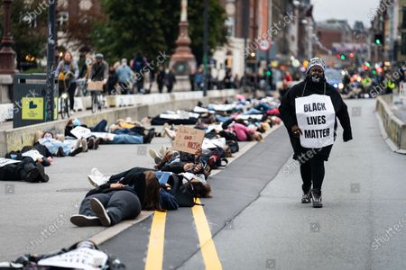 Founder and spokesperson for Black Lives Matter Denmark, Bwalya Soerensen, during demonstrations in which protesters from the movement Black Lives Matter (BLM) lie on the ground on the Queen Louise Bridge, to symbolize that Breonna Taylor was asleep when she was awakened and killed by eight shots in March 2020 in the USA, at Noerrebro in Copenhagen, Denmark, 06 October 2020. The demonstration is in solidarity with the murder of Breonna Taylor in her home and the subsequent lack of legal action against the officers involved.
