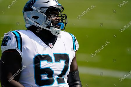 Carolina Panthers offensive guard John Miller (67) warms up before the start of an NFL football game against the Arizona Cardinals, in Charlotte, N.C