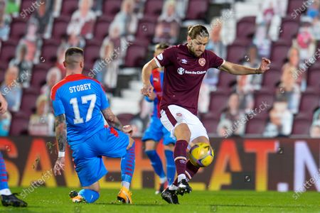 Peter Haring (#5) of Heart of Midlothian FC gets to the ball ahead of Miles Storey (#17) of Inverness Caledonian Thistle FC during the Betfred Scottish League Cup match between Heart of Midlothian and Inverness CT at Tynecastle Park, Edinburgh