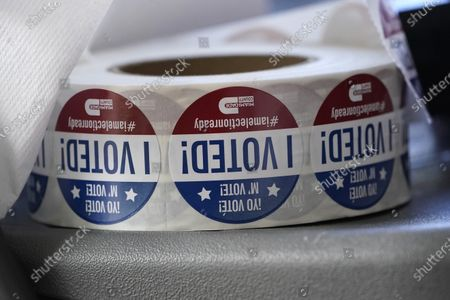 """Roll of """"I Voted!"""" stickers are shown, at the Miami-Dade County Elections Department in Doral, Fla. Florida Gov. Ron DeSantis extended the state's voter registration deadline after heavy traffic crashed the state's online system and potentially prevented thousands of enrolling to cast ballots in next month's presidential election"""