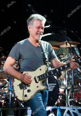 Stock Photo of Guitarist Eddie Van Halen dies of cancer at 65. In this image, Eddie Van Halen of Van Halen performs at Perfect Vodka Amphitheatre in West Palm Beach, Florida on October 15, 2015