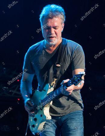 Guitarist Eddie Van Halen dies of cancer at 65. In this image, Eddie Van Halen of Van Halen performs at Perfect Vodka Amphitheatre in West Palm Beach, Florida on October 15, 2015