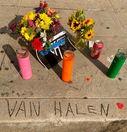 Stock Image of Legend has it that the name Van Halen, seen etched in concrete at the corner of Allen and Villa in Pasadena, Calif., was done by brothers Eddie and Alex Van Halen when they lived in Pasadena, Calif., in their younger years, where a sidewalk memorial has begun after Eddie's death from cancer at age 65, . Guitar virtuoso Eddie Van Halen is being mourned across the world of music. Artists from Lenny Kravitz to Kenny Chesney are honoring Van Halen, whose blinding speed, control and innovation propelled his band into one of hard rock's biggest groups