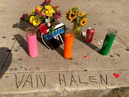 Stock Image of Legend has it that the name Van Halen, seen etched in concrete at the corner of Allen and Villa in Pasadena, Calif., was done by brothers Eddia and Alex Van Halen when they lived in Pasadena, Calif., in their younger years, where a sidewalk memorial has begun, after Eddie's death earlier in the day. Artists from Lenny Kravitz to Kenny Chesney are honoring Van Halen, whose blinding speed, control and innovation propelled his band into one of hard rock's biggest groups