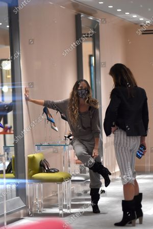 Sarah Jessica Parker helps customers at the SJP by Sarah Jessica Parker store in Midtown Manhattan.