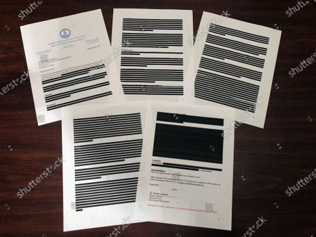Heavily redacted documents from Virginia's Office of the State Inspector General, addressed to Brian Moran, Democratic Gov. Ralph Northam's secretary of public safety and homeland security, and provided to The Associated Press in response to an open records request are displayed, in Richmond, Va. The OSIG has found new problems with victim and prosecutor notification in cases handled by the state parole board, according to other documents provided Tuesday to lawmakers