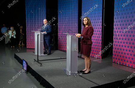 Democratic challenger Mark Kelly, left, and Republican U.S. Sen. Martha McSally are separated by plexiglass as they participate in a debate, at the Walter Cronkite School of Journalism at Arizona State University, in Phoenix