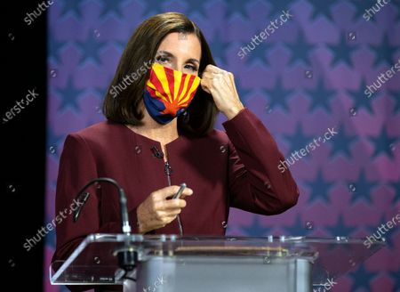 Stock Picture of Sen. Martha McSally, R-Ariz., removes her mask as she prepares to debate Democratic challenger Mark Kelly, at the Walter Cronkite School of Journalism at Arizona State University, in Phoenix