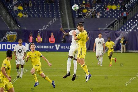 Nashville defender Dave Romney (4) and Minnesota United forward Kei Kamara (16) head the ball during the second half of an MLS soccer match, in Nashville, Tenn