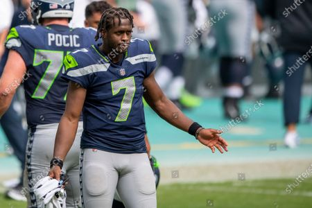 Seattle Seahawks quarterback Geno Smith (7) on the field as the Seahawks take on the Miami Dolphins during an NFL football game, in Miami Gardens, Fla