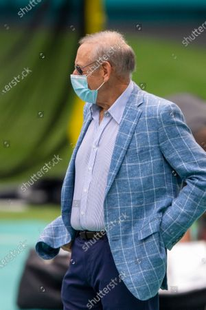 Miami Dolphins owner Stephen Ross wearing a mask, watches the players from the sidelines before taking on the Seattle Seahawks during an NFL football game, in Miami Gardens, Fla