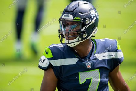 Seattle Seahawks quarterback Geno Smith (7) on the field before taking on the Miami Dolphins during an NFL football game, in Miami Gardens, Fla
