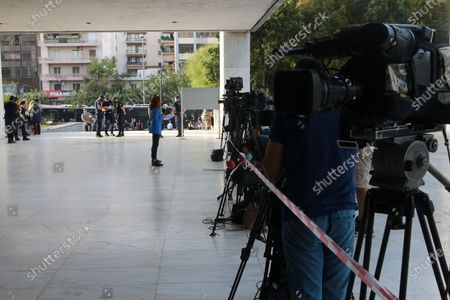Members of the media wait outside of the court for the ultra-right party Golden Dawn's (Chrysi Avgi) verdict in Athens, Greece, 07 October 2020. The verdict in the trial of the ultra-right party Golden Dawn - a trial unprecedented on a global scale in recent history - is due to be announced by an Athens Criminal Appeals Court. With its ruling, the court is called on to decide whether the accused are guilty or not guilty of forming a criminal organisation and to provide an answer to an issue of critical legal and social importance, which will have a profound impact on the present and future, regarding a political party that was elected to the Greek and European parliaments in three separate elections. Based on the charges, Golden Dawn was a criminal organisation that had the legal form of a party and enjoyed enhanced constitutional protection as a result.