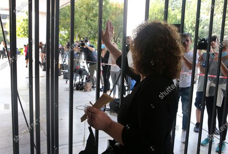 Magda Fyssa, mother of anti-fascist rapper Pavlos Fyssas, who was murdered in 2013 by a member of Golden Dawn, waves to protesters who gathered outside the court where the verdict for the ultra-right party Golden Dawn's (Chrysi Avgi) is expected in Athens, Greece, 07 October 2020. The verdict in the trial of the ultra-right party Golden Dawn - a trial unprecedented on a global scale in recent history - is due to be announced by an Athens Criminal Appeals Court. With its ruling, the court is called on to decide whether the accused are guilty or not guilty of forming a criminal organisation and to provide an answer to an issue of critical legal and social importance, which will have a profound impact on the present and future, regarding a political party that was elected to the Greek and European parliaments in three separate elections. Based on the charges, Golden Dawn was a criminal organisation that had the legal form of a party and enjoyed enhanced constitutional protection as a result.