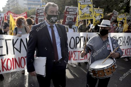 A lawyer of the trial wears a mask reading 'Nazi's in jail' during a rally outside the Athens' courthouse, while waiting for the verdict of the trial for the ultra-right party Golden Dawn's (Chrysi Avgi) in Athens, Greece, 07 October 2020. The verdict in the trial of the ultra-right party Golden Dawn - a trial unprecedented on a global scale in recent history - is due to be announced by an Athens Criminal Appeals Court. With its ruling, the court is called on to decide whether the accused are guilty or not guilty of forming a criminal organisation and to provide an answer to an issue of critical legal and social importance, which will have a profound impact on the present and future, regarding a political party that was elected to the Greek and European parliaments in three separate elections. Based on the charges, Golden Dawn was a criminal organisation that had the legal form of a party and enjoyed enhanced constitutional protection as a result.