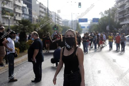 A protester wears a scarf reading 'guilty' during a rally outside the Athens' courthouse, while waiting for the verdict of the trial for the ultra-right party Golden Dawn's (Chrysi Avgi) in Athens, Greece, 07 October 2020. The verdict in the trial of the ultra-right party Golden Dawn - a trial unprecedented on a global scale in recent history - is due to be announced by an Athens Criminal Appeals Court. With its ruling, the court is called on to decide whether the accused are guilty or not guilty of forming a criminal organisation and to provide an answer to an issue of critical legal and social importance, which will have a profound impact on the present and future, regarding a political party that was elected to the Greek and European parliaments in three separate elections. Based on the charges, Golden Dawn was a criminal organisation that had the legal form of a party and enjoyed enhanced constitutional protection as a result.