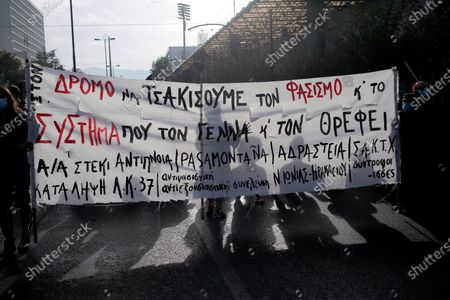 Protesters hold a banner during a rally outside the Athens' courthouse, while waiting for the verdict of the trial for the ultra-right party Golden Dawn's (Chrysi Avgi) in Athens, Greece, 07 October 2020. The verdict in the trial of the ultra-right party Golden Dawn - a trial unprecedented on a global scale in recent history - is due to be announced by an Athens Criminal Appeals Court. With its ruling, the court is called on to decide whether the accused are guilty or not guilty of forming a criminal organisation and to provide an answer to an issue of critical legal and social importance, which will have a profound impact on the present and future, regarding a political party that was elected to the Greek and European parliaments in three separate elections. Based on the charges, Golden Dawn was a criminal organisation that had the legal form of a party and enjoyed enhanced constitutional protection as a result.