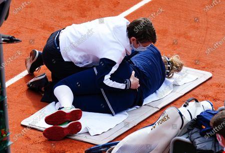 Laura Siegemund receiving treatment on her lower-back during her Women's Singles quarter-final match