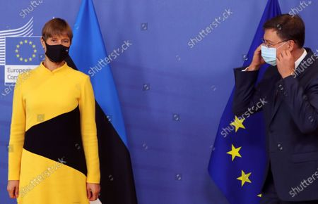 Estonian President Kersti Kaljulaid is welcomed by European Commission Vice President Valdis Dombrovskis in Brussels, Belgium, 07 October 2020.