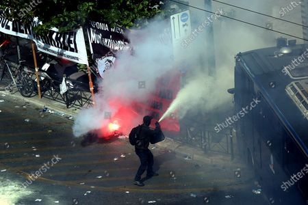 Stock Photo of Clashes between riot police and protesters after the announced of the verdict of  the trial of the ultra-right party Golden Dawn (Chrysi Avgi), in Athens , Greece, 07 October 2020. The Athens Court of Appeals returned a guilty verdict for the leadership of the far-right Golden Dawn party on charges of forming a criminal organization and announced that regional Golden Dawn cadres facing charges in the Pavlos Fyssas murder are also found guilty of joining and participating in a criminal organization. The announcement presages a guilty verdict of Golden Dawn's leadership on charges of running a criminal organization. Also, the Court found Giorgos Roupakias guilty of the murder of anti-fascist rapper Pavlos Fyssas, while finding the rest of the defendants apart from Stavros Santorinaios and Giorgos Tsakanikas, who were acquitted due to reasonable doubt, guilty as accomplices.Those facing charges in the group that attacked Fyssas, including Santorinaios, were also found guilty of the illegal possession and bearing of weapons.