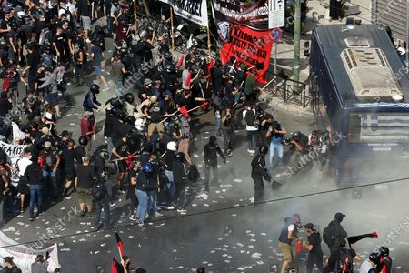 Stock Picture of Clashes between riot police and protesters after the announced of the verdict of  the trial of the ultra-right party Golden Dawn (Chrysi Avgi), in Athens , Greece, 07 October 2020. The Athens Court of Appeals returned a guilty verdict for the leadership of the far-right Golden Dawn party on charges of forming a criminal organization and announced that regional Golden Dawn cadres facing charges in the Pavlos Fyssas murder are also found guilty of joining and participating in a criminal organization. The announcement presages a guilty verdict of Golden Dawn's leadership on charges of running a criminal organization. Also, the Court found Giorgos Roupakias guilty of the murder of anti-fascist rapper Pavlos Fyssas, while finding the rest of the defendants apart from Stavros Santorinaios and Giorgos Tsakanikas, who were acquitted due to reasonable doubt, guilty as accomplices.Those facing charges in the group that attacked Fyssas, including Santorinaios, were also found guilty of the illegal possession and bearing of weapons.
