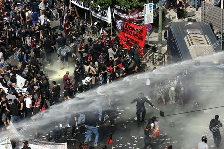 Clashes between riot police and protesters after the announced of the verdict of  the trial of the ultra-right party Golden Dawn (Chrysi Avgi), in Athens , Greece, 07 October 2020. The Athens Court of Appeals returned a guilty verdict for the leadership of the far-right Golden Dawn party on charges of forming a criminal organization and announced that regional Golden Dawn cadres facing charges in the Pavlos Fyssas murder are also found guilty of joining and participating in a criminal organization. The announcement presages a guilty verdict of Golden Dawn's leadership on charges of running a criminal organization. Also, the Court found Giorgos Roupakias guilty of the murder of anti-fascist rapper Pavlos Fyssas, while finding the rest of the defendants apart from Stavros Santorinaios and Giorgos Tsakanikas, who were acquitted due to reasonable doubt, guilty as accomplices.Those facing charges in the group that attacked Fyssas, including Santorinaios, were also found guilty of the illegal possession and bearing of weapons.