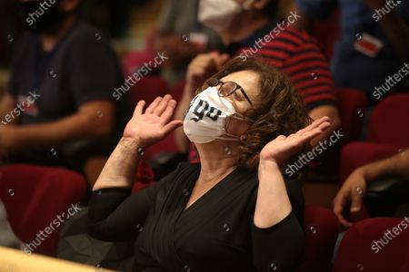 Magda Fyssa, mother of anti-fascist rapper Pavlos Fyssas, who was murdered in 2013 by a member of Golden Dawn, reacts at the announment of the ultra-right party Golden Dawn's (Chrysi Avgi) verdict in Athens, Greece, 07 October 2020. The Athens Court of Appeals returned a guilty verdict for the leadership of the far-right Golden Dawn party on charges of forming a criminal organization. Announced that regional Golden Dawn cadres facing charges in the Pavlos Fyssas murder are also found guilty of joining and participating in a criminal organization. The announcement presages a guilty verdict of Golden Dawn's leadership on charges of running a criminal organization. Also, the Court found Giorgos Roupakias guilty of the murder of anti-fascist rapper Pavlos Fyssas, while finding the rest of the defendants apart from Stavros Santorinaios and Giorgos Tsakanikas, who were acquitted due to reasonable doubt, guilty as accomplices.Those facing charges in the group that attacked Fyssas, including Santorinaios, were also found guilty of the illegal possession and bearing of weapons.