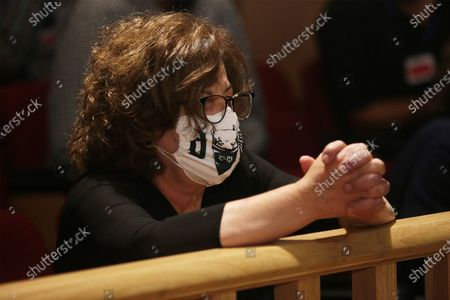 Stock Image of Magda Fyssa, mother of anti-fascist rapper Pavlos Fyssas, who was murdered in 2013 by a member of Golden Dawn, waits for the announment of the ultra-right party Golden Dawn's (Chrysi Avgi) verdict in Athens, Greece, 07 October 2020. The Athens Court of Appeals returned a guilty verdict for the leadership of the far-right Golden Dawn party on charges of forming a criminal organization and announced that regional Golden Dawn cadres facing charges in the Pavlos Fyssas murder are also found guilty of joining and participating in a criminal organization. The announcement presages a guilty verdict of Golden Dawn's leadership on charges of running a criminal organization. Also, the Court found Giorgos Roupakias guilty of the murder of anti-fascist rapper Pavlos Fyssas, while finding the rest of the defendants apart from Stavros Santorinaios and Giorgos Tsakanikas, who were acquitted due to reasonable doubt, guilty as accomplices.Those facing charges in the group that attacked Fyssas, including Santorinaios, were also found guilty of the illegal possession and bearing of weapons.