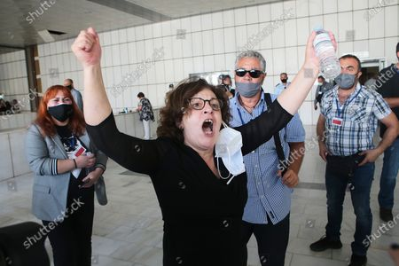 Magda Fyssa, mother of anti-fascist rapper Pavlos Fyssas, who was murdered in 2013 by a member of Golden Dawn, reacts at the announment of the ultra-right party Golden Dawn's (Chrysi Avgi) verdict in Athens, Greece, 07 October 2020. The Athens Court of Appeals returned a guilty verdict for the leadership of the far-right Golden Dawn party on charges of forming a criminal organization and announced that regional Golden Dawn cadres facing charges in the Pavlos Fyssas murder are also found guilty of joining and participating in a criminal organization. The announcement presages a guilty verdict of Golden Dawn's leadership on charges of running a criminal organization. Also, the Court found Giorgos Roupakias guilty of the murder of anti-fascist rapper Pavlos Fyssas, while finding the rest of the defendants apart from Stavros Santorinaios and Giorgos Tsakanikas, who were acquitted due to reasonable doubt, guilty as accomplices.Those facing charges in the group that attacked Fyssas, including Santorinaios, were also found guilty of the illegal possession and bearing of weapons.