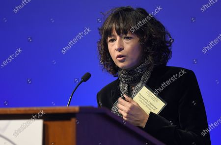 """Emmanuelle Charpentier of the Max Planck Institute for Infection Biology in Berlin, Germany, speaks on a panel at the National Academy of Sciences international summit on the safety and ethics of human gene editing in Washington. The 2020 Nobel Prize for chemistry has been awarded to Emmanuelle Charpentier and Jennifer Doudna """"for the development of a method for genome editing."""" A panel at the Swedish Academy of Sciences in Stockholm made the announcement Wednesday Oct. 7, 2020"""