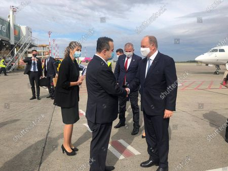 """Stock Photo of The Minister of Foreign Affairs of Serbia, Ivica Dacic, welcomed Prince Albert II of Monaco, today at the """"Nikola Tesla"""" Airport in Belgrade."""