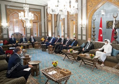 In this photo released by the Qatar Amiri Diwan, Turkish President Recep Tayyip Erdogan, second right, meets with Emir of Qatar Sheikh Tamim bin Hamad Al Thani, right, and their delegations, in Doha, Qatar