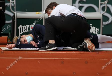Laura Siegemund of Germany receives medical treatment for her back injury during the women's singles quarterfinal match against Petra Kvitova of the Czech Republic at the French Open tennis tournament 2020 at Roland Garros in Paris, France, Oct. 7, 2020.