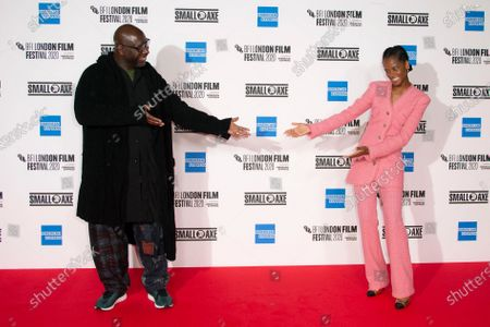 Director Steve McQueen, left and actor Letitia Wright react for photographers, during the photo call for the film 'Mangrove', as part of London Film Festival at the BFI Southbank, in central London