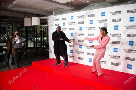 Director Steve McQueen, left and actress Letitia Wright react for photographers during the photo call for the film 'Mangrove', as part of London Film Festival at the BFI Southbank, in central London