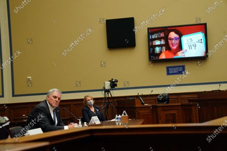 Charles P. Rettig (L), Commissioner of theInternal Revenue Service, and Erin M. Collins (2-L), National Taxpayer Advocate for the Taxpayer Advocate Service, listen as a member of the House Committee on Oversight and Reform asks a question during a hearing about the role of the Internal Revenue Service during the pandemic in Washington, DC, USA, on 07 October 2020. The House called on IRS Commissioner Charles Rettig to testify following a report from The New York Times about US President Donald J. Trump's tax returns.