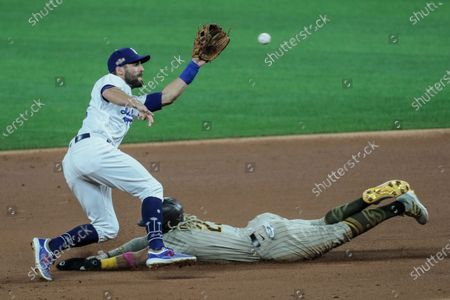 Arlington, Texas, Tuesday, October 6, 2020. San Diego Padres shortstop Fernando Tatis Jr. (23) steals second as Los Angeles Dodgers second baseman Chris Taylor (3) catches a late throw during first inning action in game one of the NLDS at Globe Life Field. (Robert Gauthier/ Los Angeles Times)