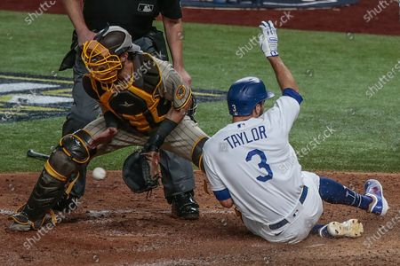 Arlington, Texas, Tuesday, October 6, 2020. Los Angeles Dodgers second baseman Chris Taylor (3) slides safely ahead of the tag of San Diego Padres catcher Austin Nola (22) during a sixth inning rally in game one of the NLDS at Globe Life Field. (Robert Gauthier/ Los Angeles Times)