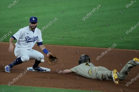 Arlington, Texas, Tuesday, October 6, 2020. Los Angeles Dodgers second baseman Chris Taylor (3) takes the late throw from catcher Will Smith as San Diego Padres right fielder Wil Myers (4) steals second base in the 4th inning in game one of the NLDS at Globe Life Field. (Robert Gauthier/ Los Angeles Times)