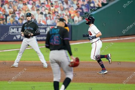 Stock Image of Miami Marlins starting pitcher Pablo Lopez (49) reacts as Atlanta Braves' Dansby Swanson, right, runs the bases after hitting a home run during the second inning in Game 2 of a baseball National League Division Series, in Houston